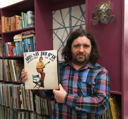 DJ Fitz holding a record from his collection