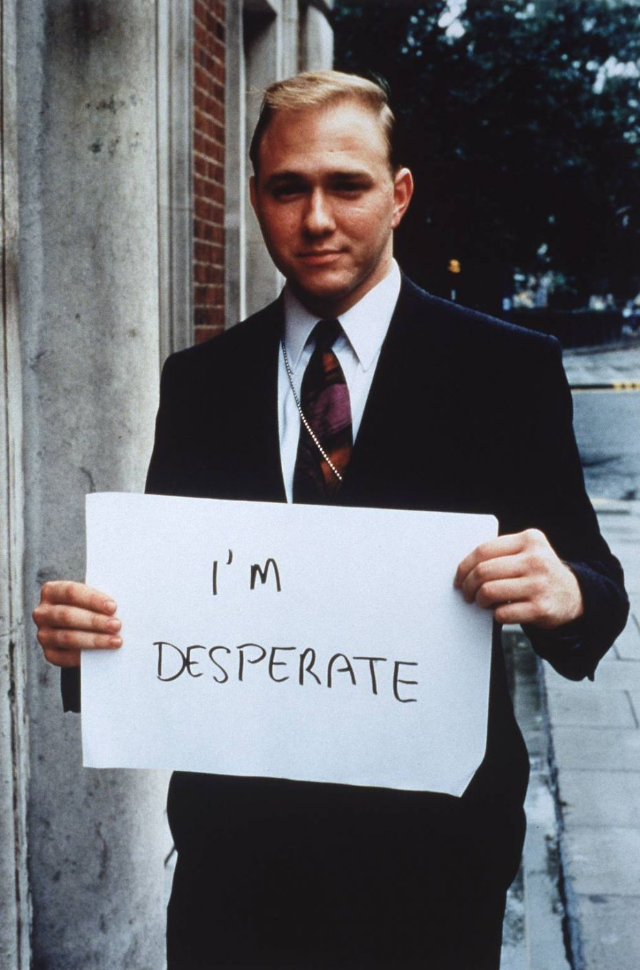Gillian Wearing's photograph 'I'm desperate' from a larger series of more than 50 works (1992-3, Framed color photographs on photographic paper mounted on board, Each 48 x 36 ¼ in.)